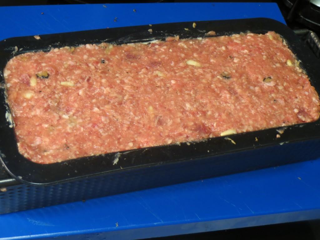 capas del pastel de carnes con jamón y trufa acabadas de poner